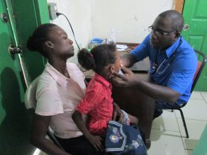 Dr Hyppolite examines a patient