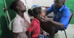 Dr Hyppolite examines a patient